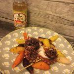 Tentacoli di polpo alla piastra su insalata di carote multicolor al burro e timo