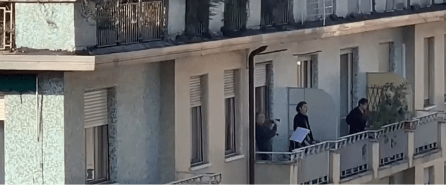 People singing from their balconies in Italy