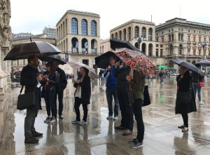 People in Milan with umbrellas