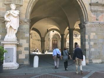 Walking under the Palazzo della Ragione to the churches