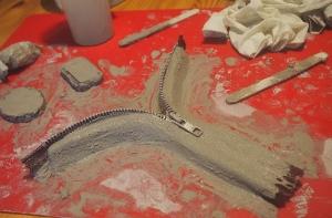 Reißverschluss und Knetbeton