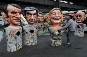 Giant figures of French politicians are seen during preparations for the carnival parade in Nice