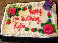 """""""A Chocolate Cake with Pink and Purple Flowers"""""""