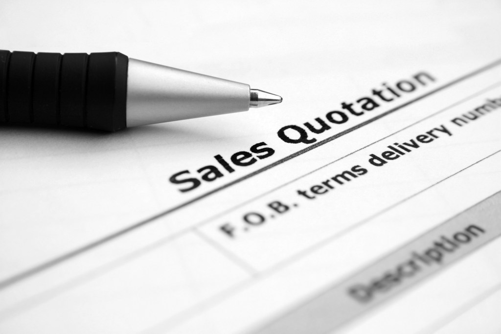 An illustration for sales quotation. Picture of a pen overlaying a Sales Quotation form.
