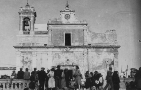 People from Sciacca, Agrigento congregating outside the local church before leaving for America.