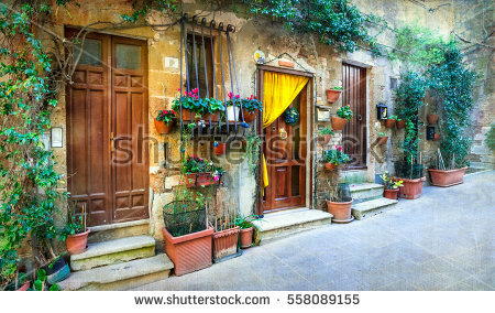 stock-photo-charming-floral-decorated-streets-of-medieval-towns-of-italy-pitigliano-558089155
