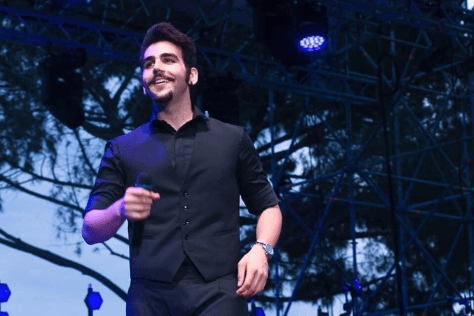 Ignazio Boschetto on stage holding a microphone