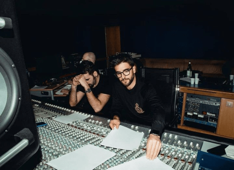 Left to right: Ignazio and Piero seated in the recording studio seated in front of a control panel