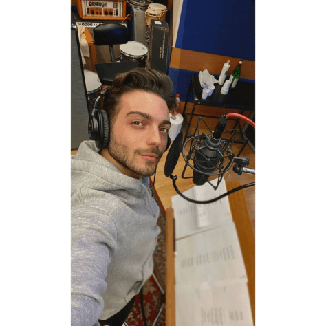Gianluca at the recording studioseated in front of a microphone