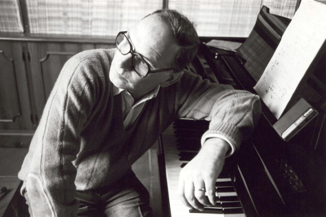 Black and white photo of Ennio Morricone at the piano