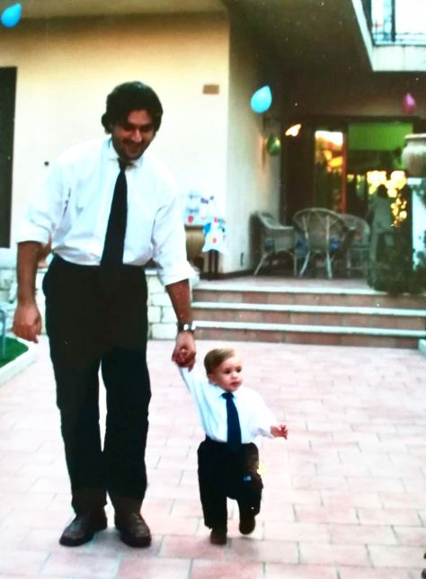 One year old Nico walking with Dad, Peppe