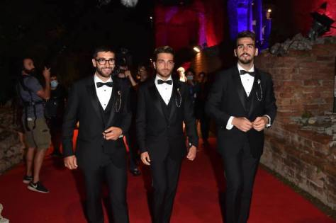 Left to right: Piero, Gianluca and Ignazio in tuxedoes walking the red carpet