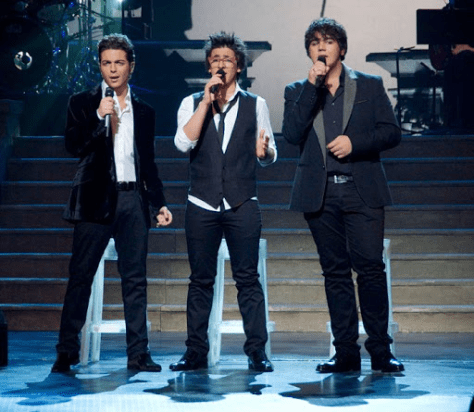 Left to right: Gianluca, Piero and Ignazio singing on stage