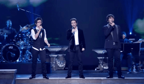 Left to right: Piero, Gianluca and Ignazio singing on stage