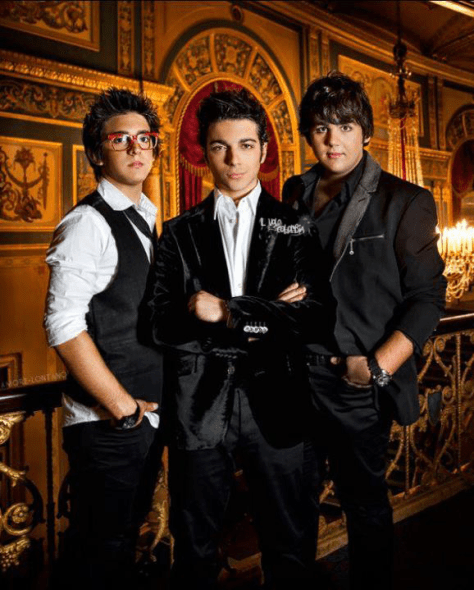 Left to right: Piero, Gianluca and Ignazio with a beautiful backdrop inside a music hall