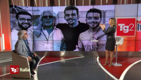 Michele Torpedine and Marzia Roncacci on stage with photo of him and IL VOLO on the screen