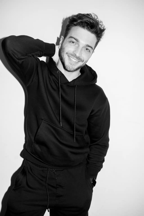 Gianluca smiling in black sweat pants and shirt