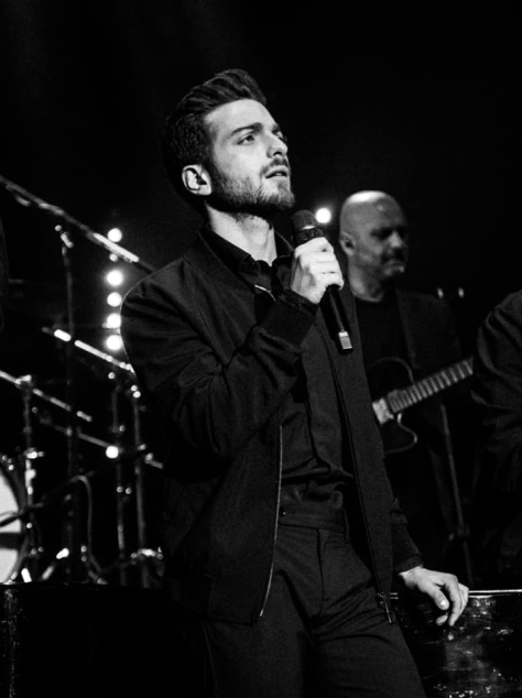 Black and white photo of Gianluca singing