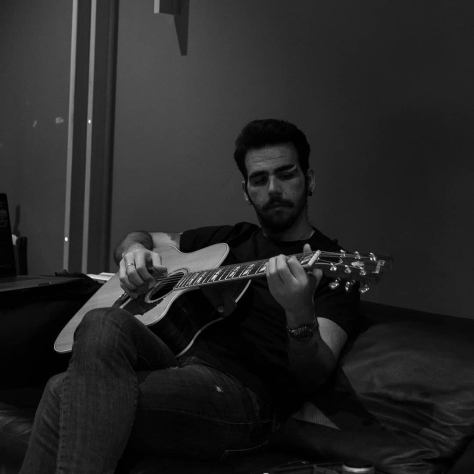 Black and white photo of Ignazio playing a guitar