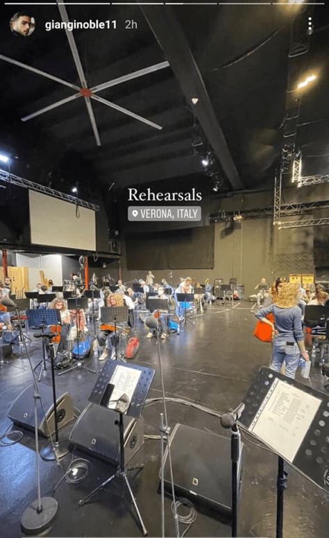 Wide shot of the rehearsal hall with musicians