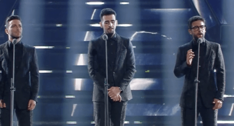 Left to right: Gianluca, Ignazio and Piero singing on the arena stage