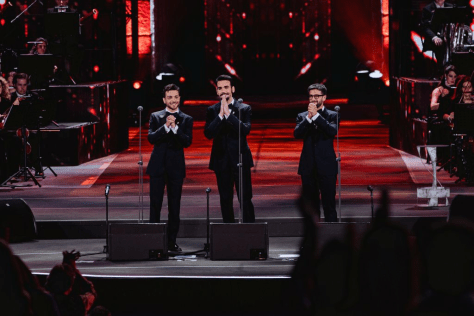 Left to right: Gianluca, Ignazio and Piero on stage in tuxedos and bow ties.