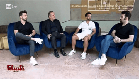 IL VOLO sitting on blue chairs being interviewed by Pascal Vicedomini