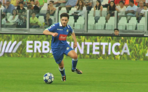 Gianluca playing soccer in a tournament