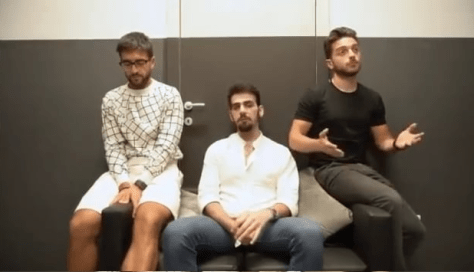 Left to right: Piero, Ignazio and Gianluca sitting on a sofa being interviewed