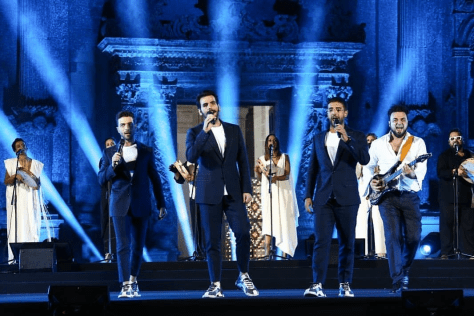 Left to right: Gianluca, Ignazio and Piero with Master Melozzi singing on stage