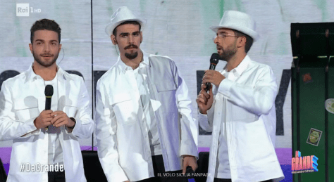 Closeup of Gianluca, Ignazio and Piero dressed in the white jackets