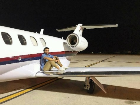 Piero sitting on the wing of a plane