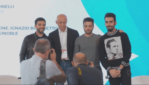 Spinelli and IL VOLO on stage posing for photographers