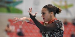 Closeup of Giada with her arms extended while skating