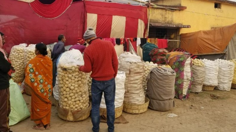 Villagers shop during Magh Purnima