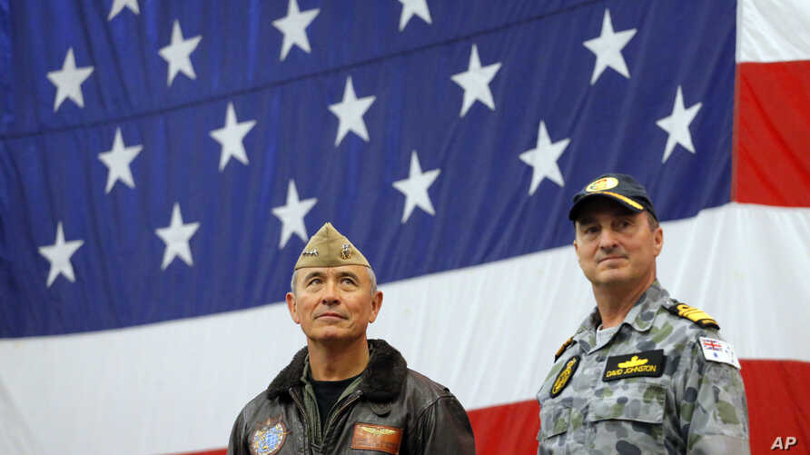 U.S. Navy Adm. Harry Harris, left, commander of the U.S. Pacific Command and Australian Navy Vice Adm. David Johnston take part in a ceremony marking the start of Talisman Saber 2017, a biennial joint military exercise between the United States and A