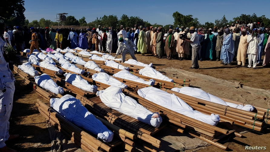 Nigeria Buries Scores of Farmers Killed by Militants, Some Beheaded | Voice  of America - English