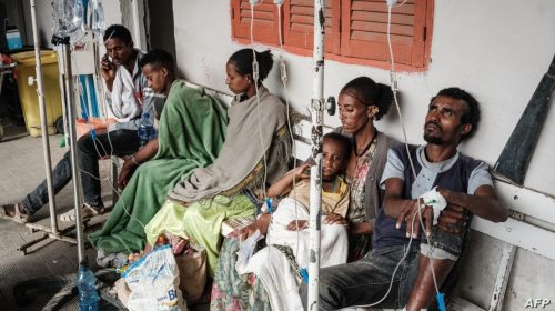 People who were injured in their town Togoga in a deadly airstrike on a market, wait on a bench for medical treatments at…