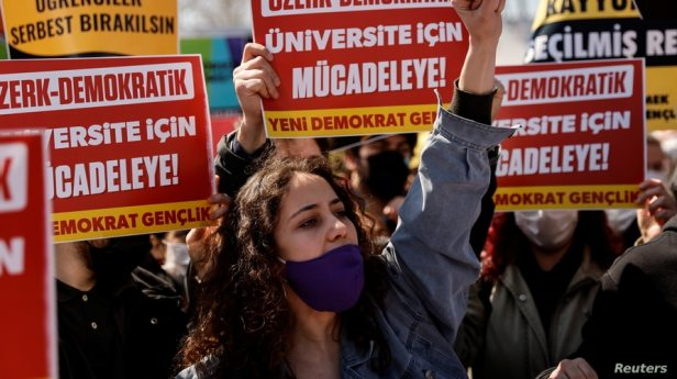 FILE - Students of Bogazici University rally against President Recep Tayyip Erdogan's appointment of a new rector for the school, in Istanbul, Turkey, March 27, 2021.