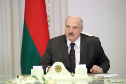 FILE - Belarusian President Alexander Lukashenko chairs a meeting with officials in Minsk, Belarus, June 19, 2020.
