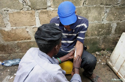 Drug users inject heroin at a construction site in Stone Town Zanzibar, December 22, 2009. An estimated 4,000-6,000 narcotics…