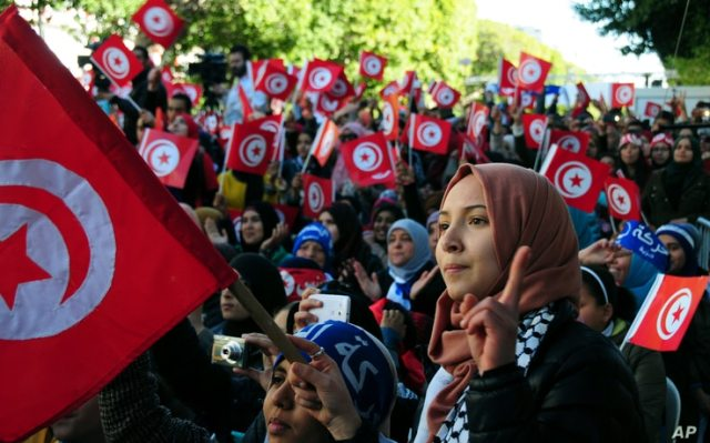 FILE - Tunisians celebrate the fifth anniversary of the Arab Spring, in Tunis, Jan.14, 2016. A new Arab Youth Survey found just five years after the Arab spring, a majority of respondents prioritized stability over democracy in the region.