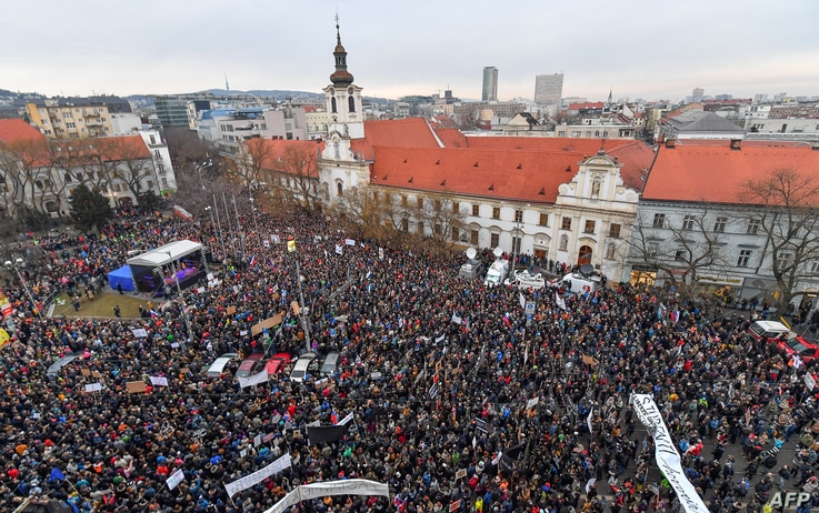"""People gather at Slovak National Uprising (SNP) square during a rally under the slogan """"For a Decent Slovakia"""", against corruption and to pay tribute to murdered Slovak journalist Jan Kuciak and his fiancee Martina Kusnirova on March 9, 2018 in Brati"""