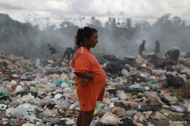 Venezuelan Astrid Prado, who is 8 months pregnant, is seen at a garbage dump in the border city of Pacaraima, Brazil, April 13, 2019.