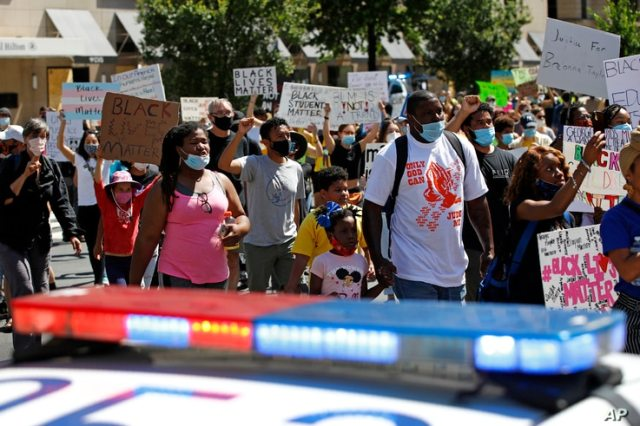 Protesters demonstrate Saturday, June 13, 2020, near the White House in Washington, over the death of George Floyd, who died after being restrained by Minneapolis police officers.