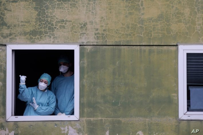 Medical staff work at one of the emergency structures that were set up to ease procedures at the Brescia hospital, northern Ital