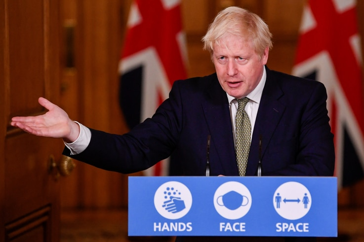 Britain's Prime Minister Boris Johnson gestures as he speaks during a virtual news conference on the ongoing situation with the coronavirus disease (COVID-19), at Downing Street, London, Oct. 12, 2020.
