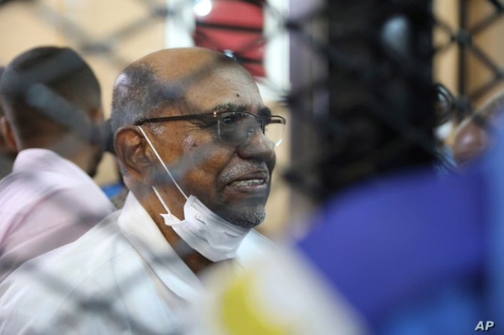 FILE - In this Sept. 15, 2020 file photo, Sudan's ousted president Omar al-Bashir sits at the defendant's cage during his trial…