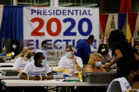 Elections workers open ballots at the Palm Beach County Elections Office during the 2020 U.S. presidential election in West…