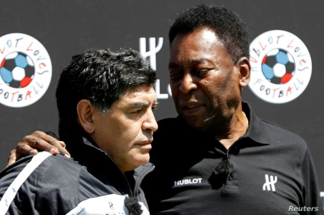 FILE PHOTO: Football legends Pele (R) and Diego Maradona attend an advertising soccer event on the eve of the opening of the…